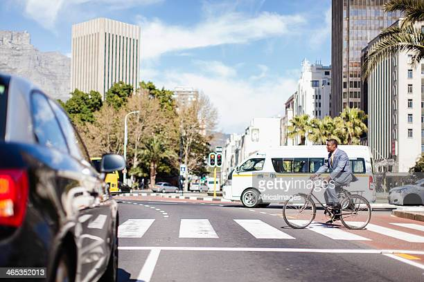 African businessman cycling on Adderley St, Cape Town