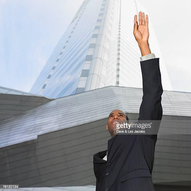African businessman hailing taxi cab