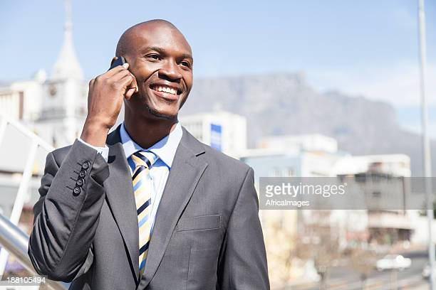African businessman having a conversation on the phone