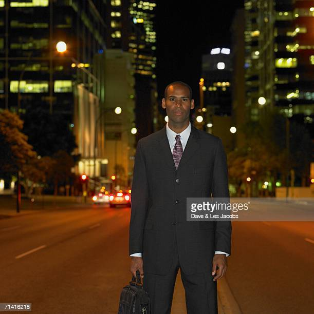 African businessman in urban setting at night