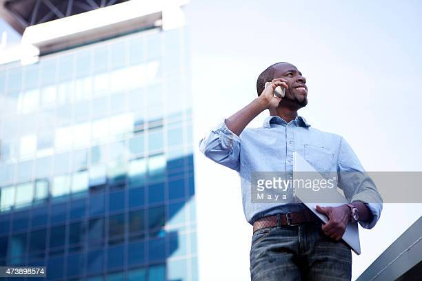 African businessman outside office building