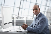 African businessman sitting at conference table