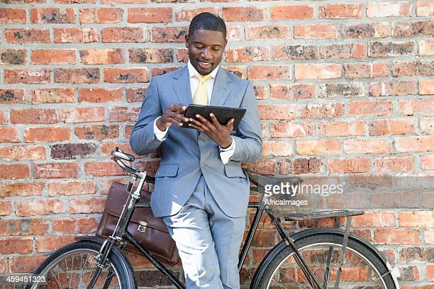 African businessman sitting on his bicycle.