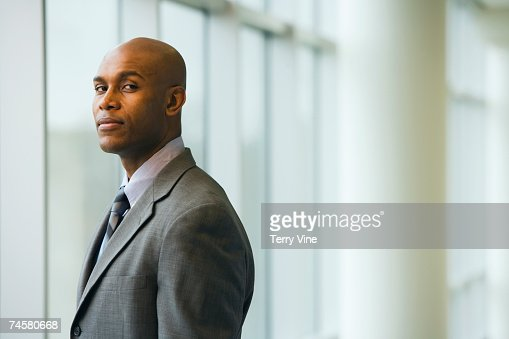 African businessman standing next to window : Stock-Foto
