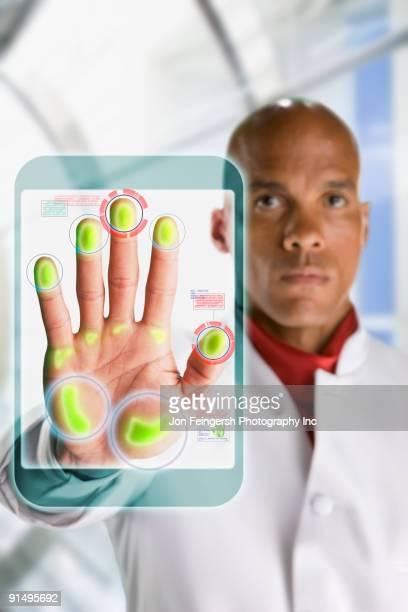 African businessman touching hi-tech door access lock