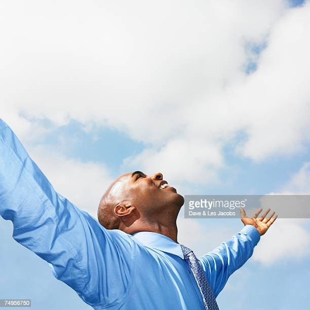 African businessman with arms outstretched
