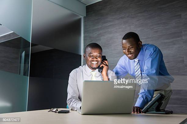 African businessmen working together on an assignment.