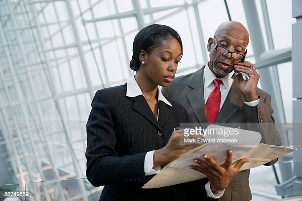 African businesspeople reviewing paperwork