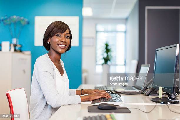 African businesswoman busy typing on her computer