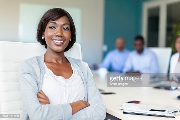 African businesswoman looking at the camera in the boardroom
