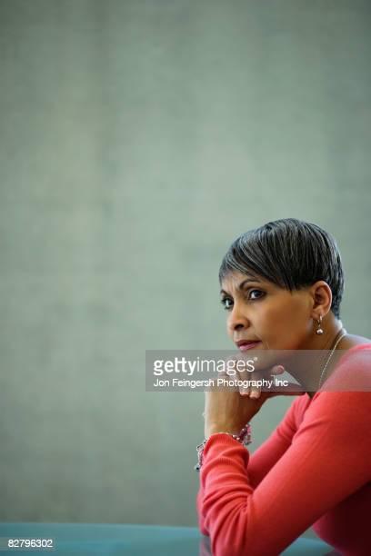 African businesswoman looking pensive