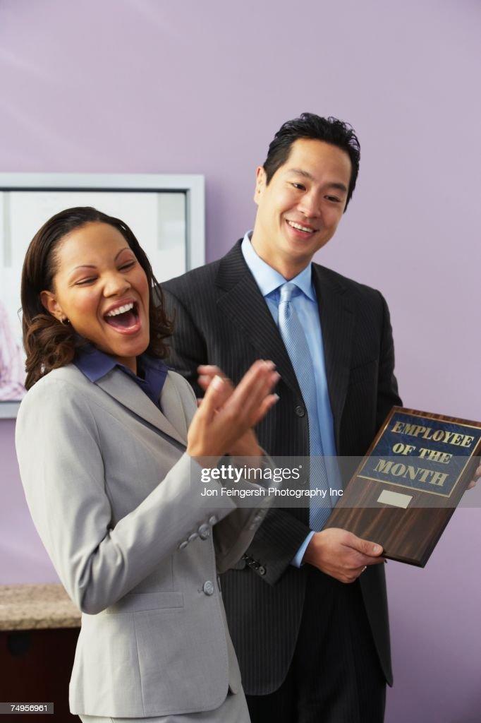 African businesswoman receiving award : Stock Photo
