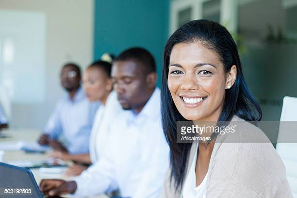 African businesswoman smiling at the camera