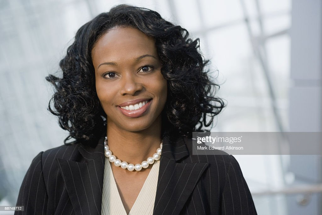African businesswoman smiling : Stock Photo
