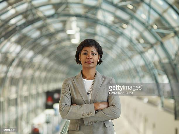 African businesswoman standing with arms crossed