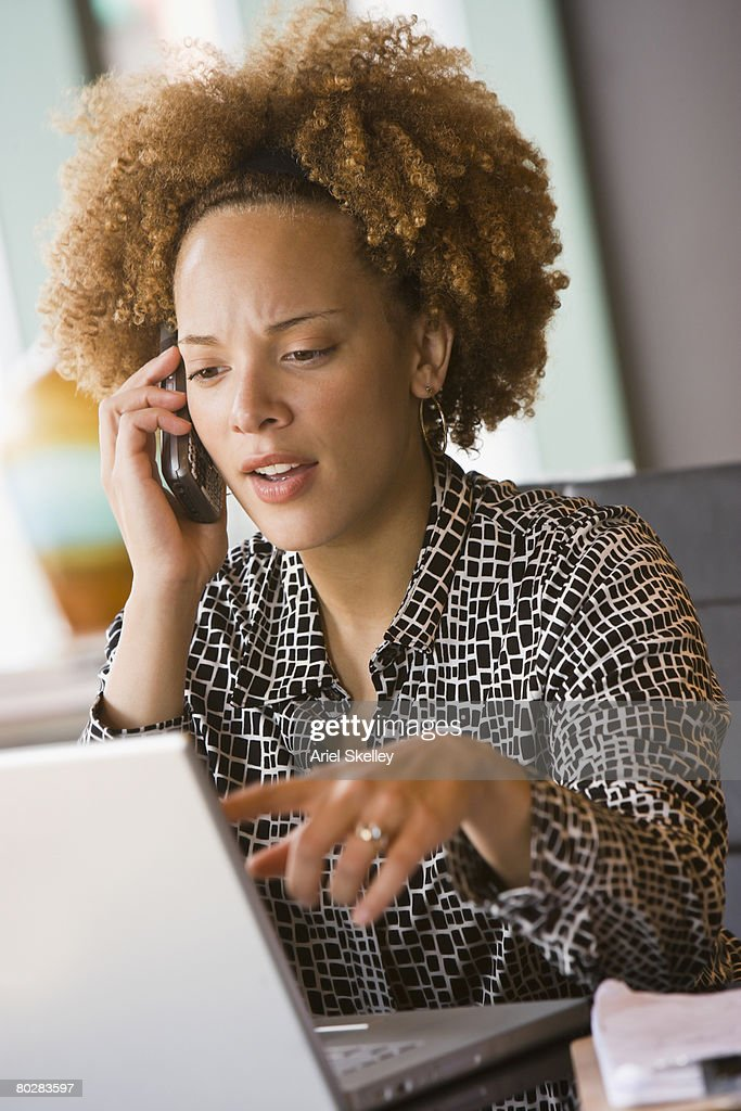 African businesswoman talking on cell phone : Stock Photo