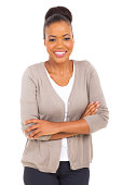 happy african businesswoman with arms crossed