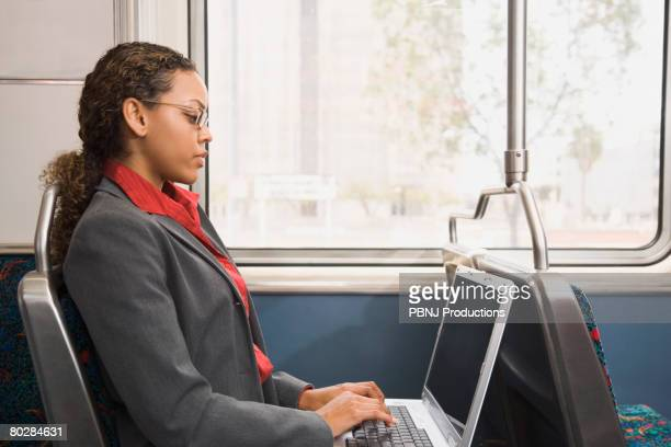 African businesswoman working on train