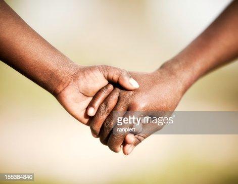 アフリカにお子様を持つ手