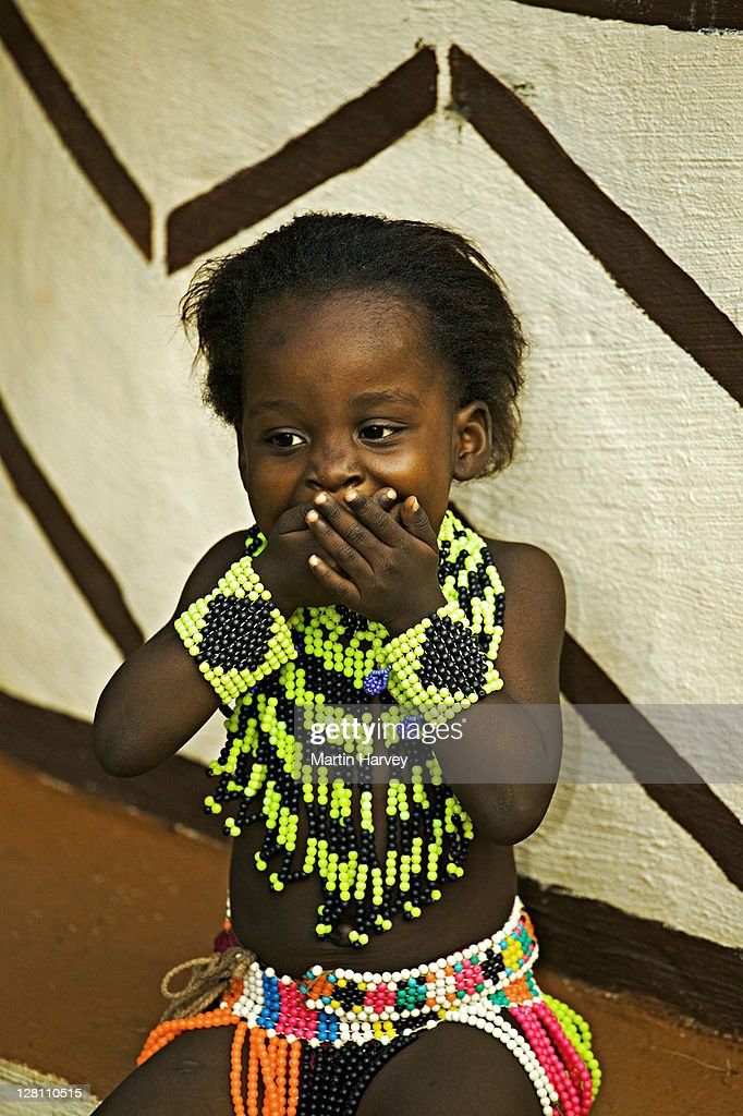 African Child In Brightly Colored Beads And Outfit Lesedi ...