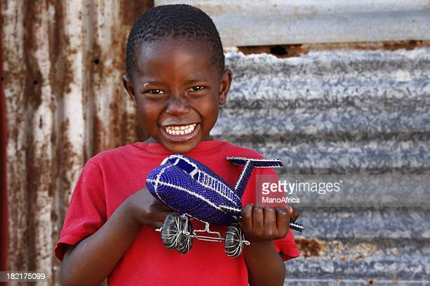 African child toy aeroplane