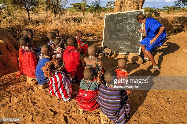 African children in the school under tree, Kenya, East Africa