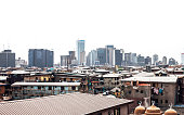 African city skyline. Small mosque in the front.