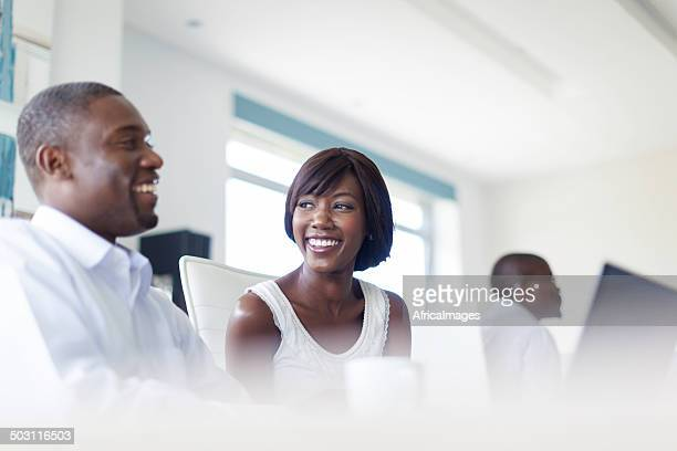 African colleagues laughing and smiling in the boardroom