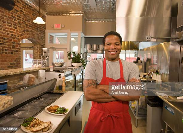 African cook standing in commercial kitchen