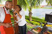 African couple barbecuing