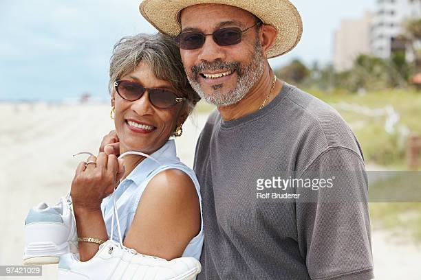 African couple enjoying beach