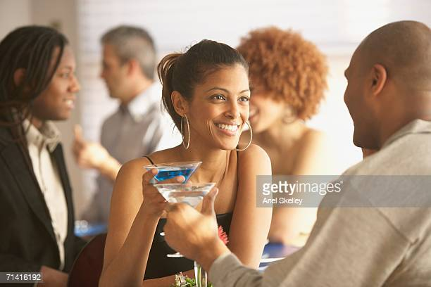 African couple having cocktails at a restaurant
