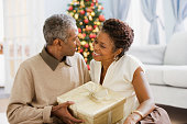 African couple holding Christmas gift