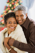 African couple hugging on Christmas