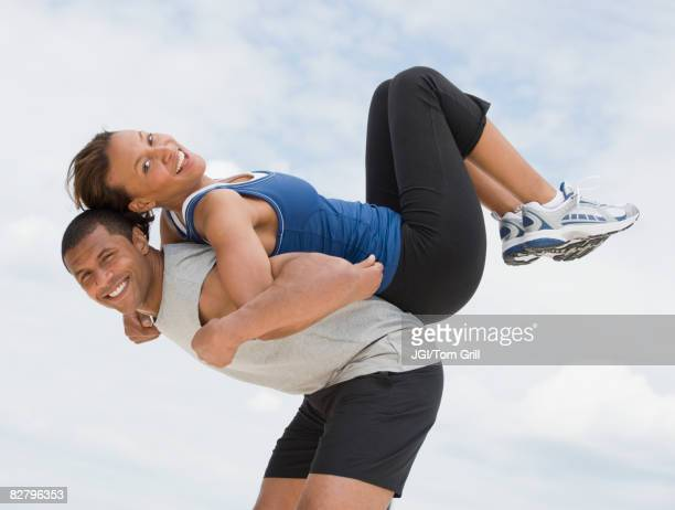 African couple in athletic clothing