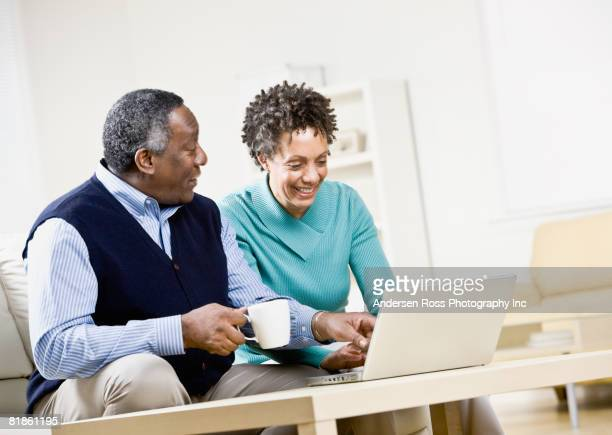 African couple looking at laptop