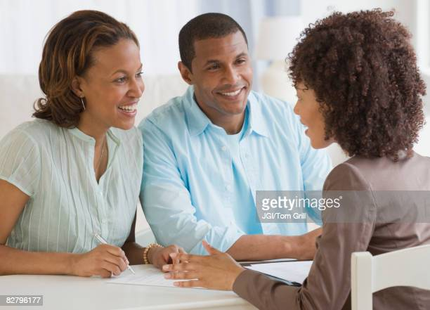 African couple receiving financial consultation