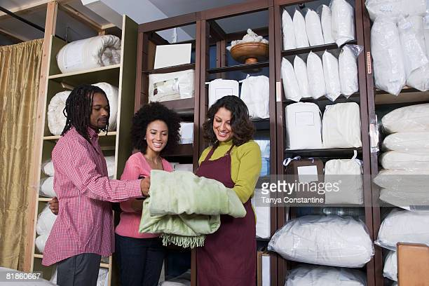 African couple shopping for bedding