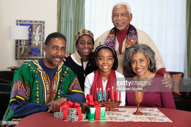 African couple with family celebrating Kwanzaa