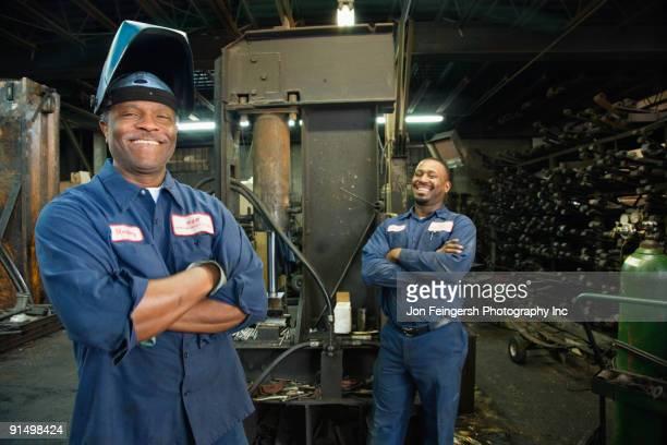 African co-workers in repair shop