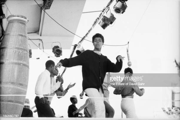 African dance troupe Olantunji Dance Troupe performs at the Newport Folk Festival in July 1960 in Newport Rhode Island
