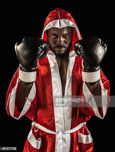 African descent boxer in red gown