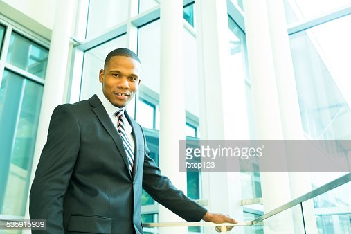 African descent business man in office building. Suit and tie. : Stock Photo