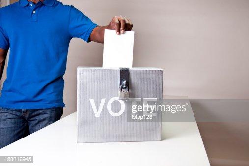 African descent man casting his vote. Ballot box.
