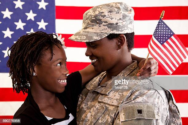 African descent military family with American flag.