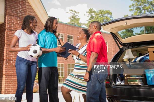 African descent teenage boy moves into college dorm.