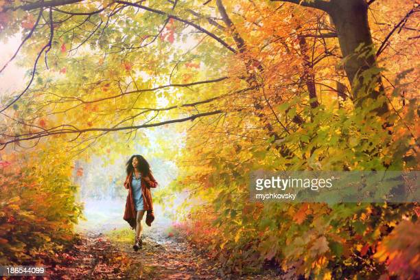 African descent woman in autumn forest.