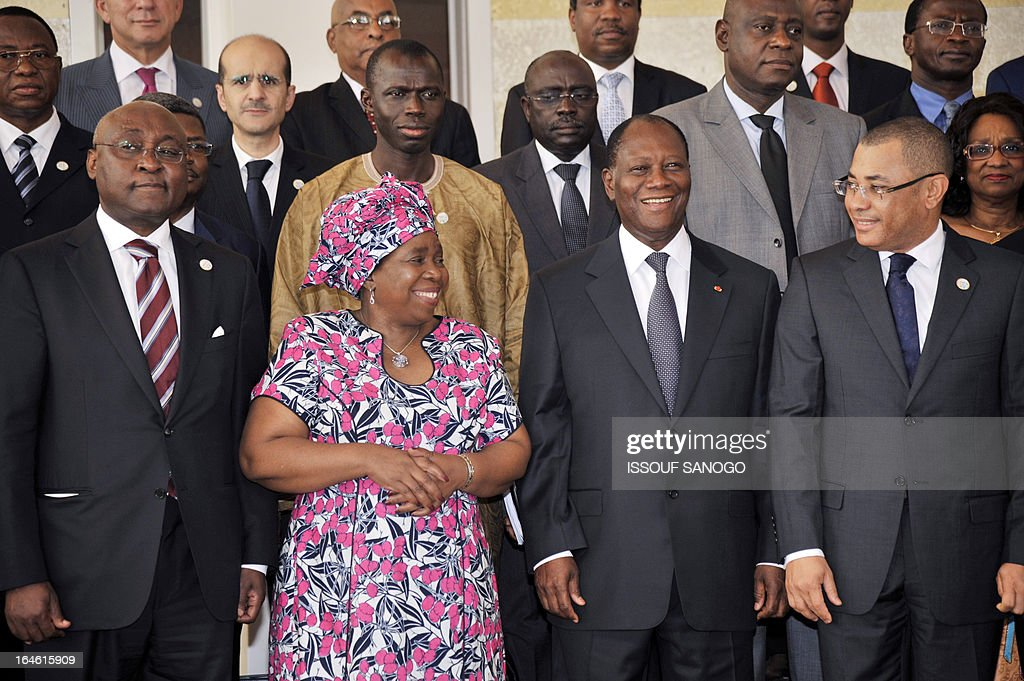 African Development Bank Chairman (BAD) Donald Kaberuka, African Commision President Nkosazana Dlamini-Zuma, Ivory Coast's President Alassane Ouattara and Gabon's Deputy Minister to the Minister of Economy, Employment and Sustainable Development Desire Guedon pose on March 25, 2013 for the family photo during the opening of the sixth meeting of the finance and economy ministers and the African Union Development Planning in Abidjan.