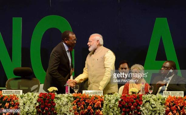African Development Bank President Akinwumi Adesina shakes hands with Indian Prime Minister Narendra Modi at the start of the African Development...