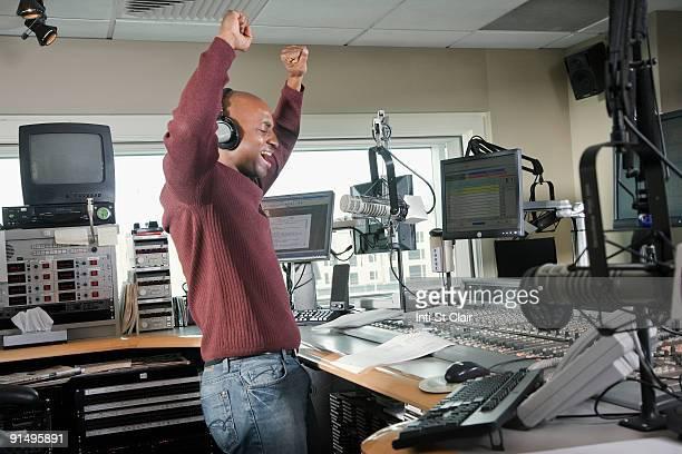 African dj working at radio station